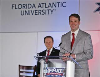 Lane Kiffin, John Kelly