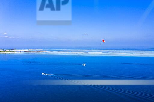 Maldives, South Male Atoll, aerial view of paraglider on the sea at an atoll