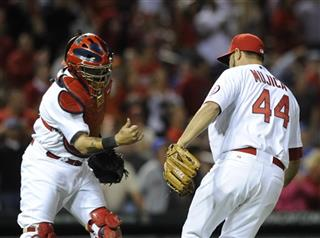Yadier Molina, Edward Mujica