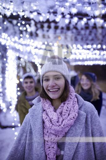 Portrait of happy young woman in winter decoration