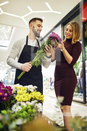 Florist advising customer in flower shop