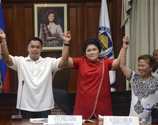 Imelda Marcos, Joel Gines, left, Cecilia Aribuabo.