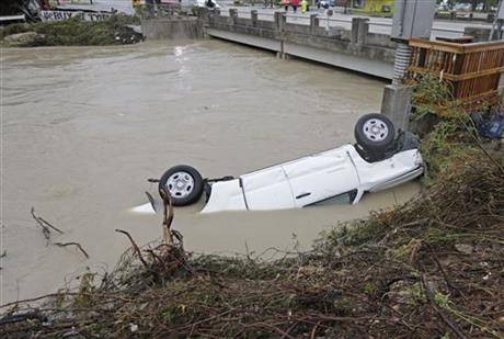 Car submerged in flood waters. Gills Creek near a bridge in Columbia, S.C.