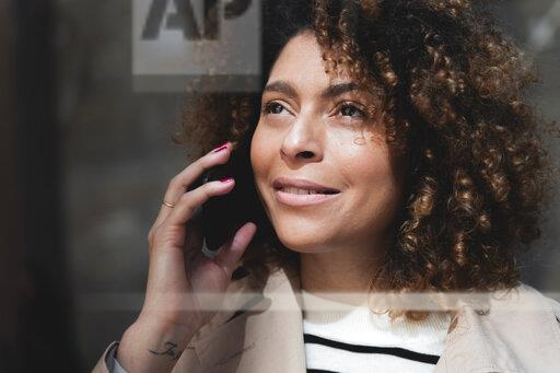 Portrait of smiling woman talking on cell phone