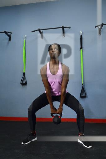 Woman practicing with kettlebell in a gym