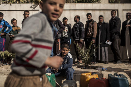 UN refugee agency hands out aid to those uprooted from Mosul