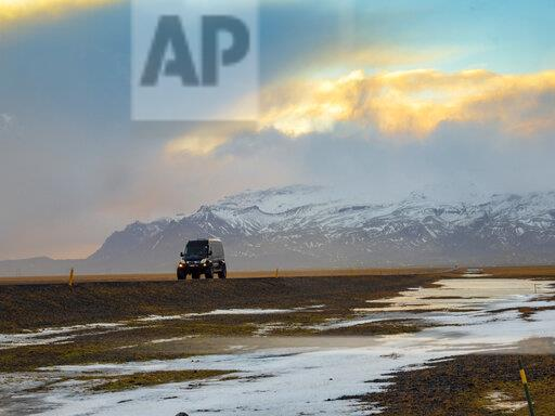 Iceland, off-road vehicle on country road