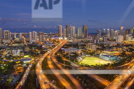 Highways intersections merging with Highway US 1 through downtown Miami at night, aerial view, Miami, Florida, United States