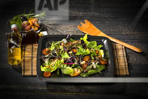 Leaf lettuce with steamed plums, champignons, almonds and cress
