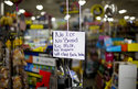 A message greets shoppers of supplies no longer available as Hurricane Florence approaches the east coast in Nichols, S.C., Thursday, Sept. 13, 2018. The residents of this tiny inland town who rebuilt after Hurricane Matthew destroyed 90 percent of the homes are uneasy as forecasters warn inland flooding from Florence's rain could be one of the most dangerous and devastating parts of the storm. (AP Photo/David Goldman)