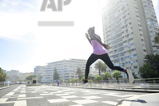Sportive woman jumping outdoors
