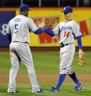 Juan Uribe, Mark Ellis
