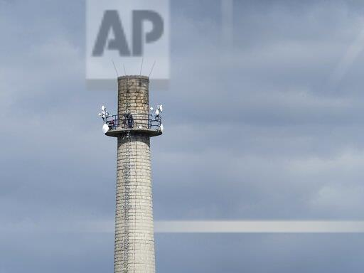 Factory chimney, antennas, stairs, people