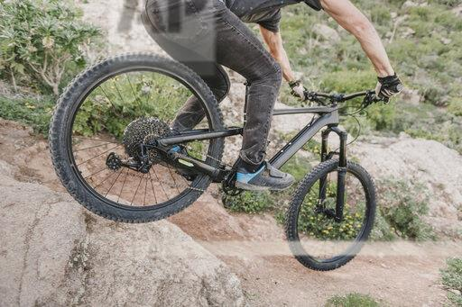 Spain, Lanzarote, close-up of mountainbiker on a trail in the mountains