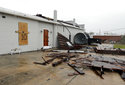 Part of the roof of Tidewater Brewing Co. lies on the ground in Wilmington, N.C., after Hurricane Florence made landfall Friday, Sept. 14, 2018. (AP Photo/Chuck Burton)