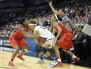 Layshia Clarendon is fouled by Georgia's Shacobia Barbee, left and Tiaria Griffin