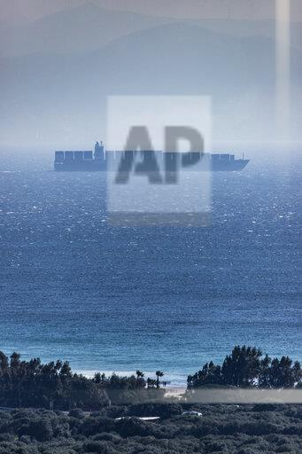 Spain, Andalusia, Tarifa, Strait of Gibraltar, container ship and fog