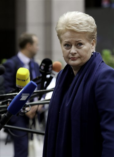 Lithuanian President Dalia Grybauskaite speaks with journalists as she arrives for an EU summit in Brussels, Saturday, Aug. 30, 2014. EU leaders, in a one day summit, are set to decide who will get the prestigious job as the 28-nation bloc's foreign policy chief for the next five years. They will also discuss the current situation in Ukraine. (AP Photo/Virginia Mayo)