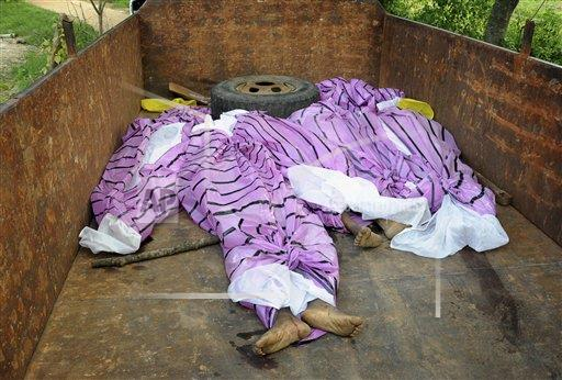 The bodies of women, who have been accused of practicing witchcraft, are placed in a truck in Kinjia village in Jharkhand state, India, Saturday, Aug. 8, 2015. Dozens of villagers in eastern India beat to death five women Saturday, accusing them of practicing witchcraft and blaming them for a series of misfortunes in the village, police said.