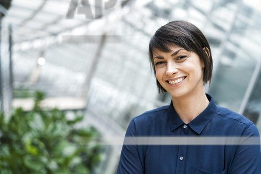 Portrait of smiling businesswoman in sustainable office building