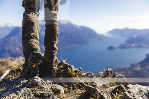 Italy, Como, detail of hiking boots on the rock