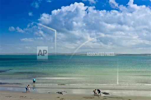 Creative Robert Harding Productions /AP Images A  County Clare Republic of Ireland 1161-6745 Family fun at the sandy beach on the west coast near Doonbeg, County Clare, West Coast of Ireland