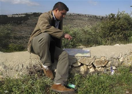 George Abu Eid looking at map near village of Beit Jala