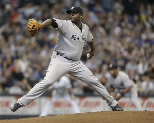 2New York Yankees starting pitcher CC Sabathia throws to the Milwaukee
