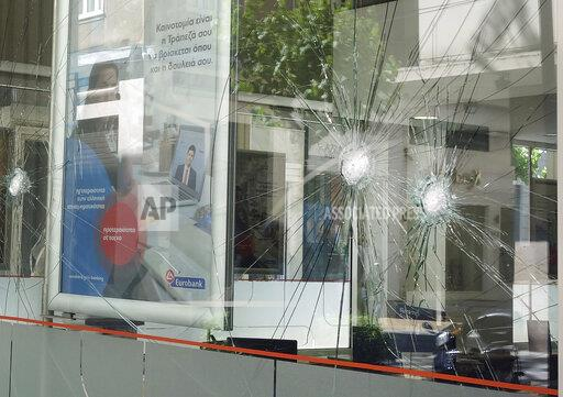 Shattered shop windows in Athens