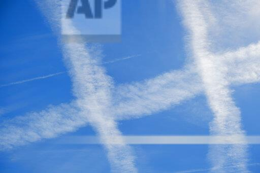 Germany, Bavaria, vapour trails of airplanes in the sky