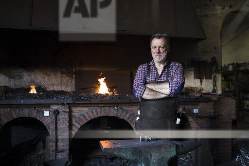 Portrait of confident blacksmith in his workshop