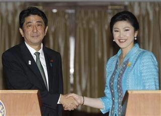 Shinzo Abe, Yingluck Shinawatra
