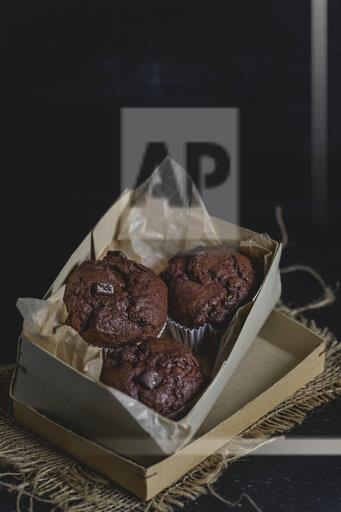 Chocolate muffins in a cardboard box