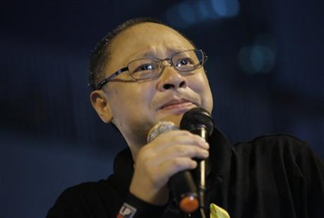 Founder of the Occupy Central civil disobedience movement Benny Tai cries during a rally outside government headquarters after protesters were threatened by residents and pro-Beijing supporters in Kowloon's crowded Mong Kok district, Friday, Oct. 3, 2014 in Hong Kong.