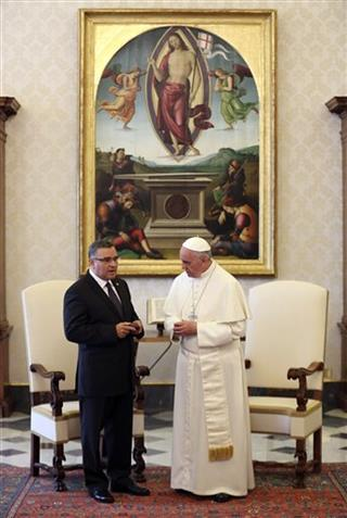 Pope Francis chats with El Salvador's President Funes during a meeting at the Vatican