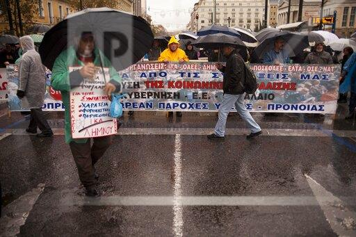 Despite heavy rain, Greek pensioners are protesting cuts and demanding that pensions be paid on time.