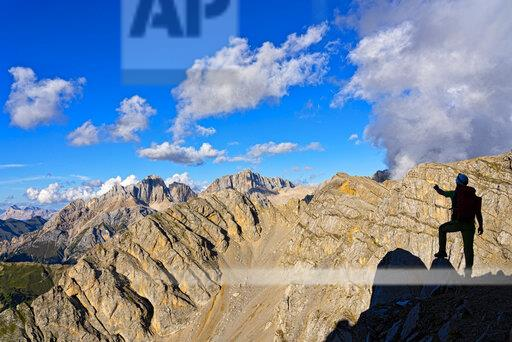 Italy, Veneto, Dolomites, Alta Via Bepi Zac, mountaineer standing on Costabella mountain