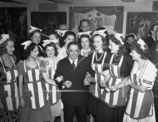 Watchf AP A  NY USA APHS311874 Mayor Fiorella LaGuardia surrounded hostesses