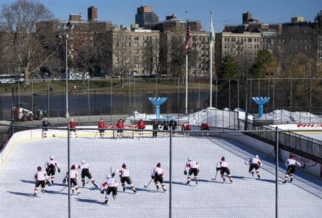 The calgary flames practice on a rink in new york s central park