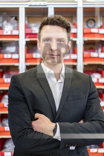 Portrait of confident businessman in factory