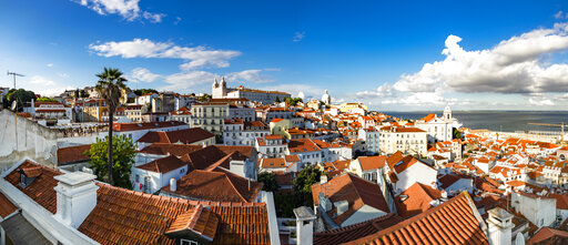 Portugal, Lisbon, Alfama, View from Miradouro de Santa Luzia over district with Sao Vicente de Fora Monastery, River Tagus, panoramic view
