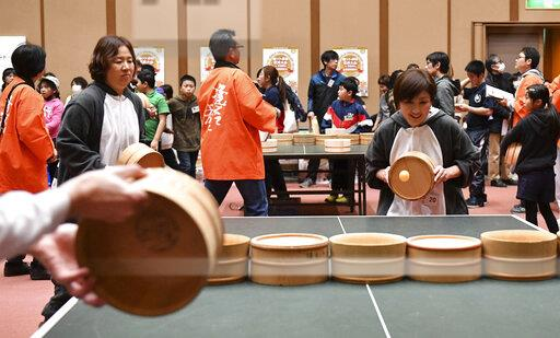 Table Tennis by wooden bucket in Japan