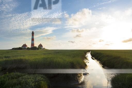 Germany, Westerhever, lighthouse in sunset