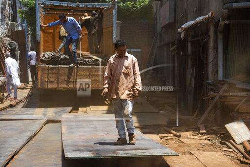 Scrap dealers in Srinagar, India - 02 Jul 2019