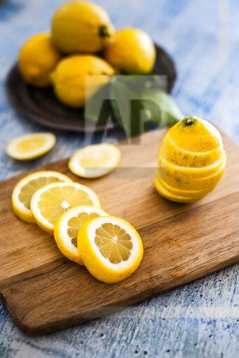 Sliced lemons on wooden board