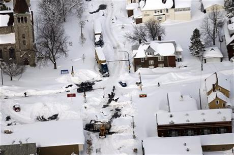 Cars make their way through South Buffalo, N.Y.,Wednesday, Nov. 19, 2014.