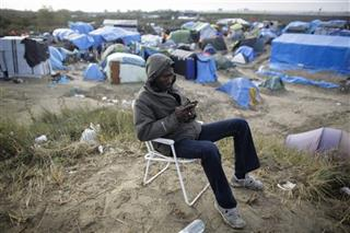 France Migrants Calais Camp Passing Time