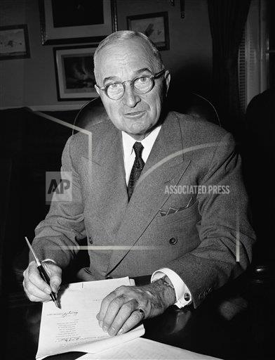 Watchf AP A  DC USA APHS330770 President Harry Truman signs a proclamation