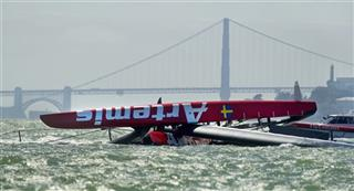 APTOPIX Americas Cup Capsized Boat Sailing