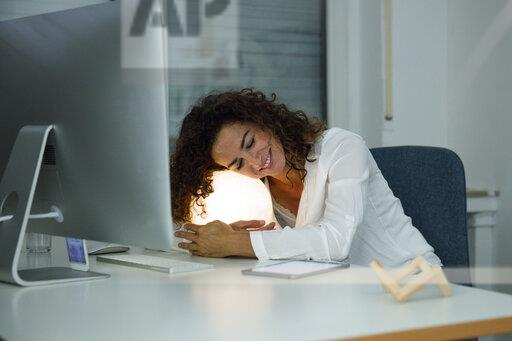 Businesswoman working overtime in her office